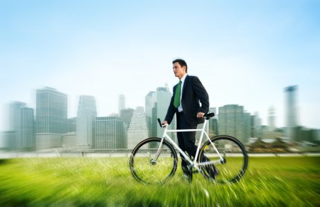 business man pushing bike